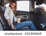 young  beautiful woman fastens... | Shutterstock . vector #432304069