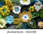 Crocheted flowers and leaves - stock photo