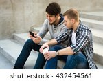 two guys sitting on stairs with ... | Shutterstock . vector #432454561