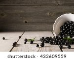 Black Currant On Wooden Table...