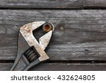 Small photo of Adjustable wrench, monkey-wrench and old wood