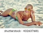 young woman on a beach | Shutterstock . vector #432637681