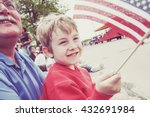 Boy And His Father Watching A...