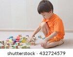 boy playing blocks | Shutterstock . vector #432724579