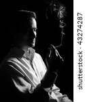 man thinks and smokes a cigarette. Monochrome - stock photo