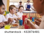 Stock photo primary school kids at a table in school cafeteria close up 432876481