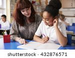 primary school teacher with a... | Shutterstock . vector #432876571