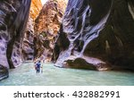 people hiking in zion narrow  with  virgin river in summer season,Zion National park,Utah,usa.