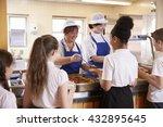 two women serving kids food in...   Shutterstock . vector #432895645