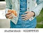 young woman eating fast food... | Shutterstock . vector #432899935