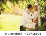man in embroidered shirt kisses ... | Shutterstock . vector #432916801