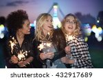Girls With Fireworks At The...