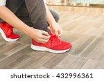 young man runner tying his... | Shutterstock . vector #432996361