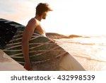 portrait of a surfer walking by ... | Shutterstock . vector #432998539