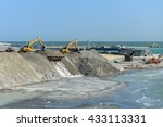 Small photo of AL KHOBAR, SAUDI ARABIA - 31 MAY 2016: Heavy plant machinery moves sand in the construction of the new reclaimed island as part of the King Fahd Causeway toll highway between Bahrain and Saudi Arabia.
