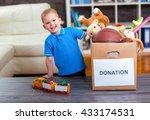 boy taking donation box full... | Shutterstock . vector #433174531