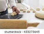 baker kneading dough in a... | Shutterstock . vector #433273645