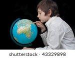 Young Man Looking At The Globu...