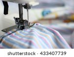 sewing machine and cut of fabric | Shutterstock . vector #433407739