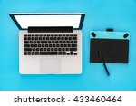 laptop  pen mouse on blue table ... | Shutterstock . vector #433460464