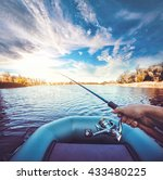 Young Man Fishing On A Lake....