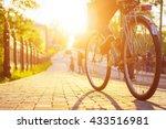 bike at the summer sunset on... | Shutterstock . vector #433516981