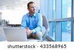 handsome businessman sitting at ... | Shutterstock . vector #433568965