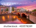 Stock photo amsterdam the netherlands sunset on the bridge 433578289
