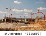Construction Cranes On A Blue...