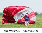 Skydiver With Red Parachute...