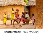 Small photo of ACCRA, GHANA - MARCH 6, 2012: Unidentified Ghanaian women and their children on a bench near their house in the street. Children of Ghana suffer of poverty due to the unstable economic situation