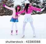 Two Beautiful Girls Wearing...