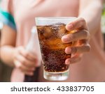 Woman Hand Giving Glass Of Col...