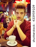 young man drinking coffee in... | Shutterstock . vector #433959109