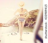slim woman and blue bikini  | Shutterstock . vector #433989415