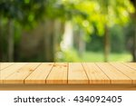 wood floor with blurred trees... | Shutterstock . vector #434092405