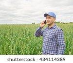 farmer in a plaid shirt... | Shutterstock . vector #434114389