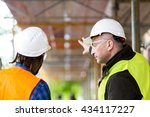 two architects wearing hardhat... | Shutterstock . vector #434117227