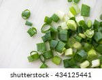 chopped green onions on white... | Shutterstock . vector #434125441