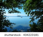 idyllic lake view with boat and ... | Shutterstock . vector #434223181