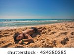 smiling boy enjoys the sun on a ... | Shutterstock . vector #434280385