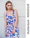 beautiful young girl wearing a... | Shutterstock . vector #434323135