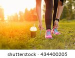 woman lacing running shoes... | Shutterstock . vector #434400205