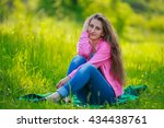 sitting beautiful girl | Shutterstock . vector #434438761