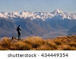 a female hiker looks towards... | Shutterstock . vector #434449354