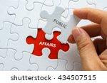 hand holding piece of jigsaw... | Shutterstock . vector #434507515