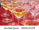 glasses of white wine on the... | Shutterstock . vector #434515159
