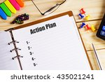 """action plan"" text on paper in... 