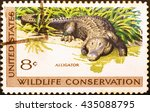 Small photo of Milan, Italy - February 01, 2014: American Alligator on american postage stamp