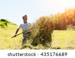 Man Farmer Turns The Hay With ...